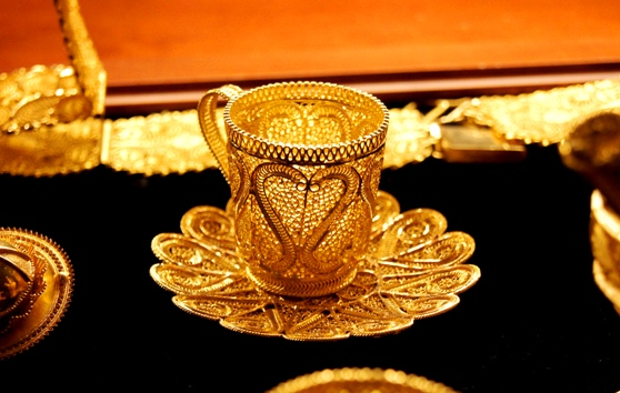 golden coffee cup